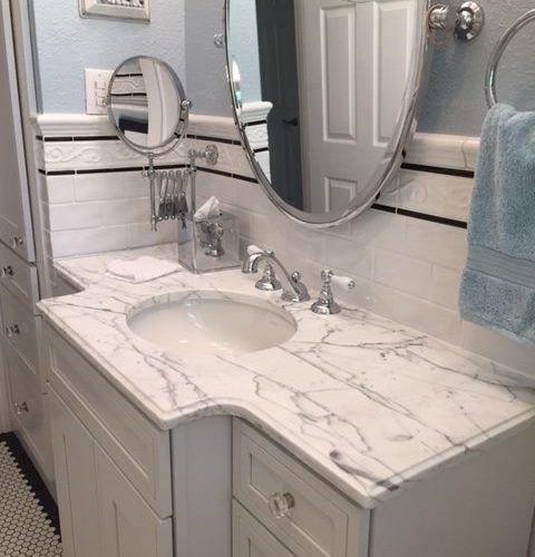 bath remodeling with granite countertops and clean design